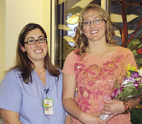 Nurse Practice Council Chairperson Becky Cox, RN (left), presents Andrea Brecht, RN (right) with the 2015 Nurse of the Year award.