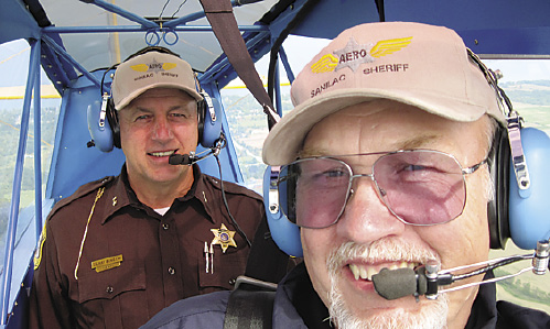 Sheriff Garry Binieki and deputy Tim Juhl flying a search for two hunters missing in the Minden State Game Area
