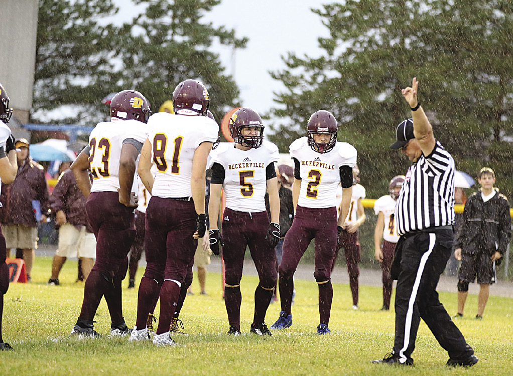 #23 Donovin Snyder, #81 Austin Spaetzel, #5 Austin Fritch and #2 Lukas Auerswald watch the referee step off yardage at the 54-0 win against the CPS Tigers.