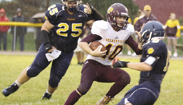 Deckerville's Jeffrey Stone carries the ball against the CPS Tigers, where a steady rain, and a delay, didn't deter the Deckerville Eagles in their win
