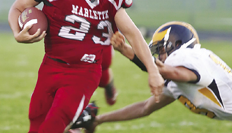 Marlette's Ethan Stover #23 eludes would be tacklers for a sizeable gain.  Stover rolled up 99 all purpose yards.
