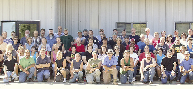 Midwest Rubber employees gather for a group photo in front of their factory home. The company has been located in Deckerville since 1958.
