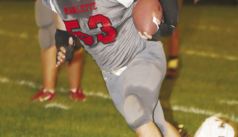 Chorben Chisholm, Fullback for Marlette breaks through the Memphis defense for a touchdown.
