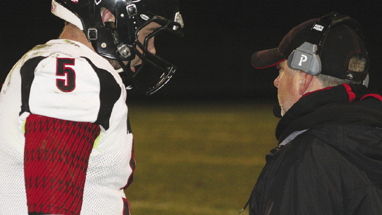 Coach of the year Craig Jacobson gives QB Brandon Potter some words of wisdom from  the sidelines.