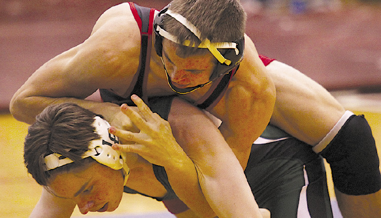 Tate Larson fought his way to 7-0 at Warren Mott.