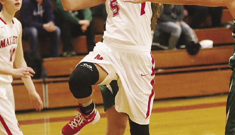 Emily Schaub drives the lane for two.