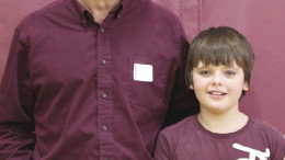 Fifth grader Dylan Roach poses for the camera with Marty Lagina.