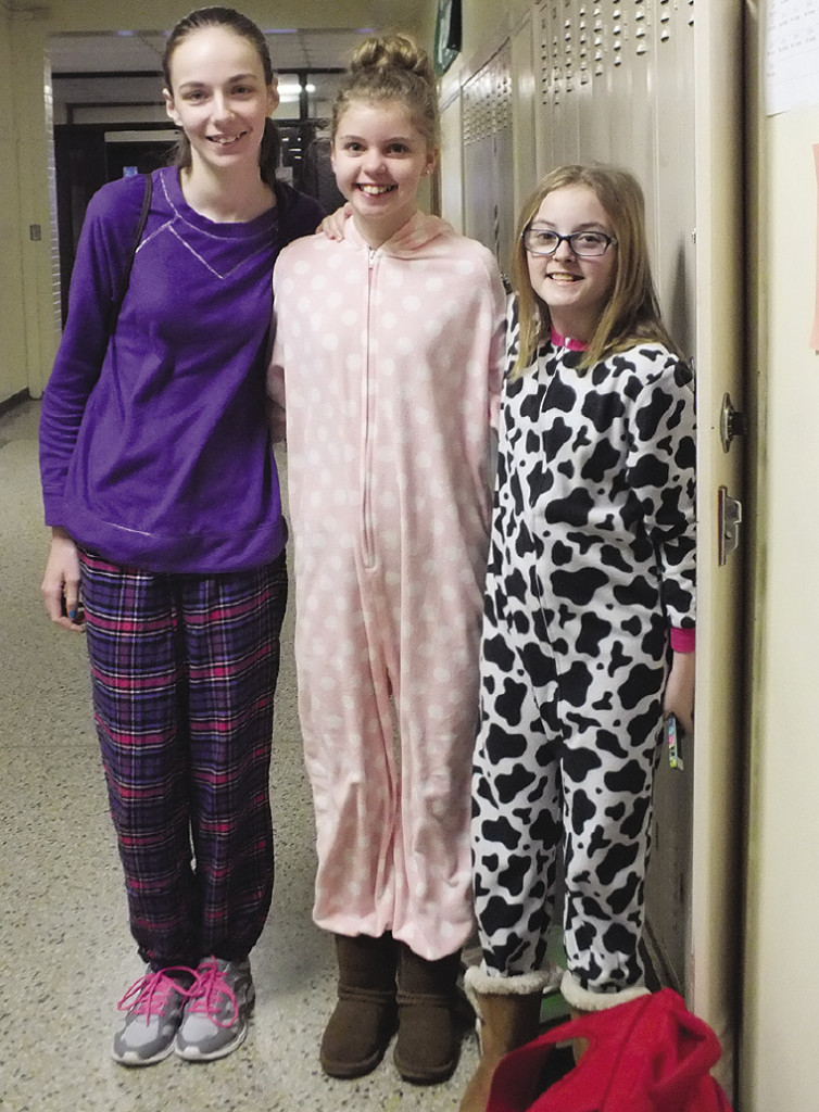 "Amy Boyne, Sarah Keyworth, Savannah Phillips show their school spirit during the ""get up and go"" dress up day."